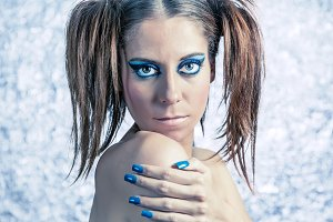 Woman with pigtails and blue makeup