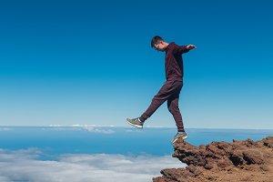 Extreme man standing and balancing