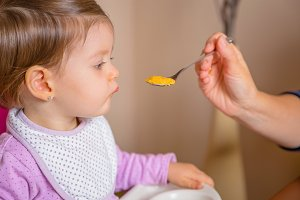 Baby eating puree from a spoon