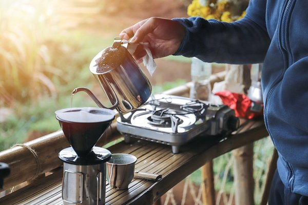 Hands drip coffee with morning ligh…