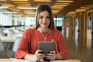 Young female student studying in the