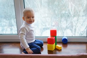Boy and color cubes