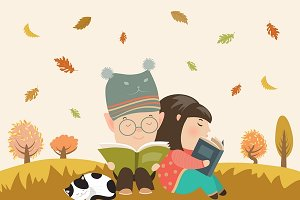 Kids reading book at autumn meadow