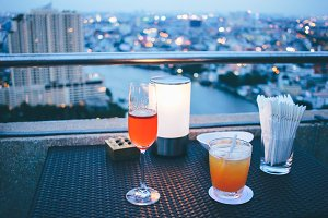 Cocktail glasses in rooftop bar