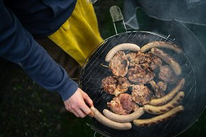 Sausage and meat on the grill at the