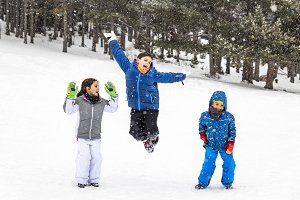 Three kids jumping together