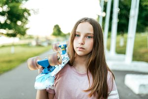 Girl with a skate on her shoulder