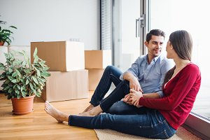 Young couple in love moving in a new