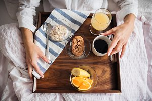 A midsection of woman with breakfast