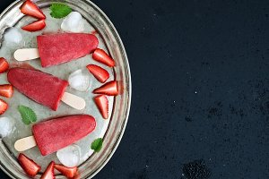 Strawberry ice-creams or popsicles