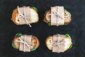 Sandwiches wrapped in craft paper