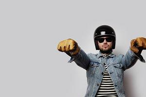 Young biker in a blue denim jacket