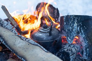 Kettle boils on fire campfire