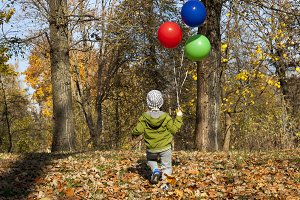 A child with balloons