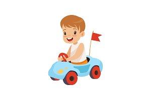 Cute Smiling Boy Riding Toy Car