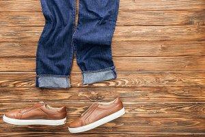 Top view of denim pants and brown sh