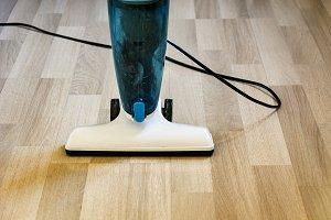 Vacuum cleaner on a light parquet