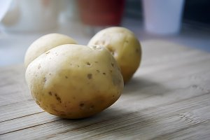 raw potatoes on a wooden table