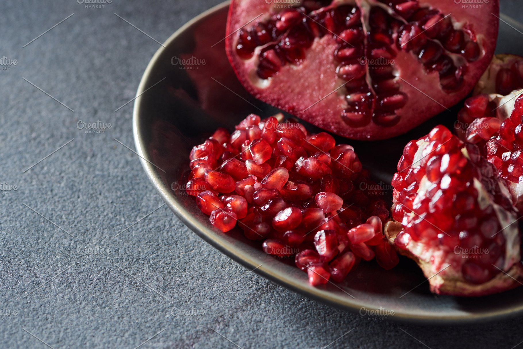 Studio Shot Of Cut Pomegranate In Me Food Drink Photos