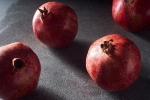 Studio shot of fresh pomegranates on