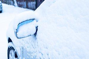Car mirror after snowstorm