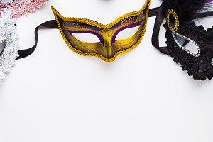 Colorful carnival masks on white