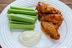 Buffalo chicken wings with celery an