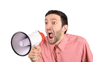 Young man screaming on a megaphone.