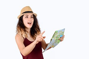 Young tourist woman looking at map.