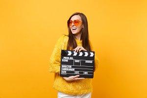 Cheerful young woman in sweater oran