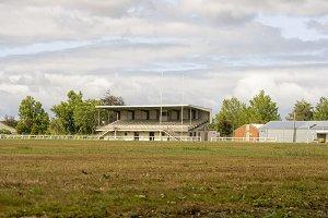 Empty rugby field with tribune