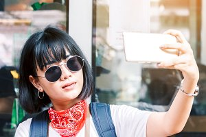Woman take selfie from smartphone