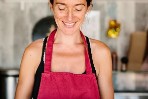 Smiling woman in food truck giving s