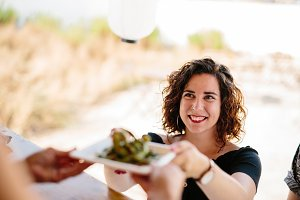 Content woman receiving meal in food
