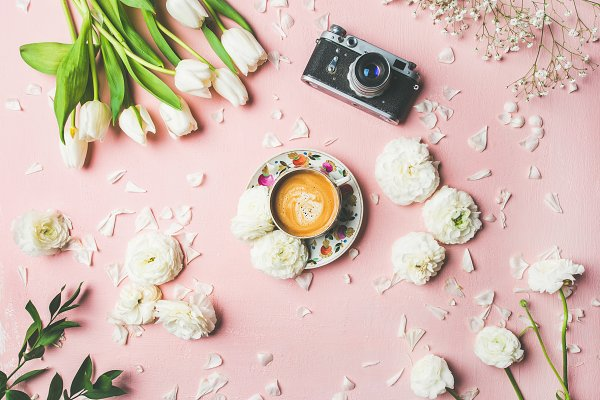 Spring layout with coffee, camera