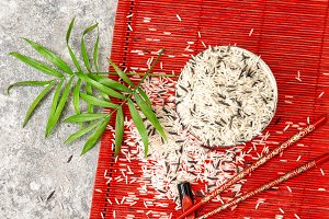 Rice bowl chopsticks palm leaves red