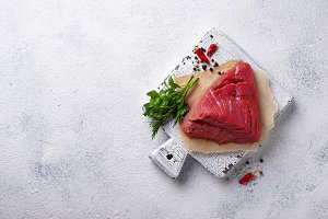 Raw meat on cutting board with