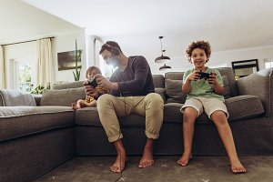 Man playing video game with his kids