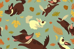 Dogs playing with autumn leaves