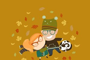 Couple lying among fallen leaves