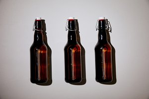 brown bottles with beer on white bac