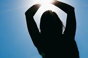 Backlighting of a woman doing yoga