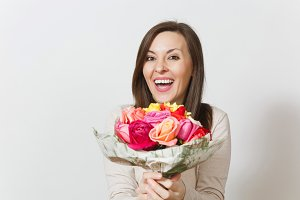 Young smiling woman holding bouquet