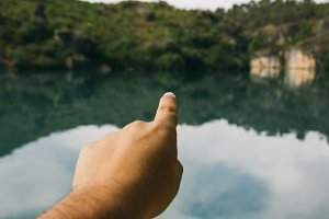 Finger pointing to a lake