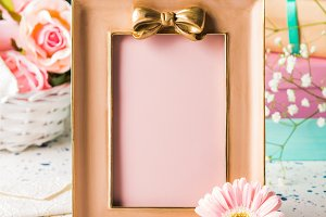 Pink frame with bow and flowers