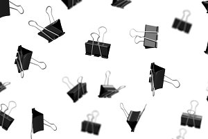 Black paper binder clips in the air