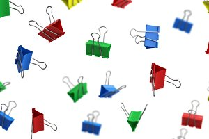 Colorful paper binder clips in the a
