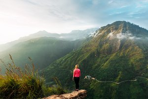 Girl meets sunrise in the mountains