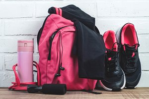 Pink backpack with sportswear, sneak