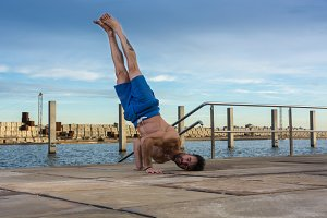 Man performing advanced yoga exercis